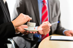 Businesspeople in business office drink coffee Stock Photos