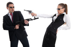 Businesspeople. Business people with guns isolated over white Royalty Free Stock Photography