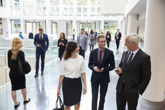 Businesspeople In Busy Lobby Area Of Modern Office royalty free stock images