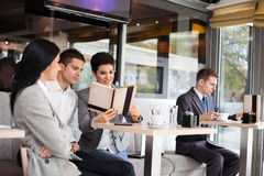 Businesspeople in cafe Stock Images