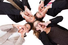 Businesspeople calling out. Conceptual image of four businesspeople with their heads together looking directly down at the camera isolated on white Stock Photos