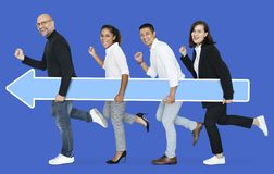 Businesspeople carrying a blue arrow to the goal stock photography