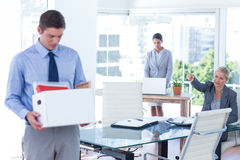 Businesspeople carrying their belongings in box Stock Photography