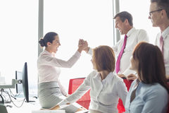 Businesspeople celebrating success in office royalty free stock photography