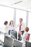 Businesspeople celebrating success in office Royalty Free Stock Image