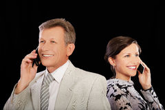 Businesspeople with cellphones Stock Photos