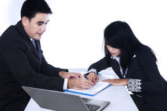 Businesspeople checking business contract Stock Photos