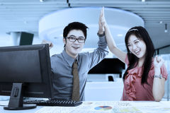 Businesspeople clapping hands in the office Stock Photos