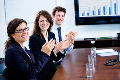 Businesspeople clapping on training royalty free stock images