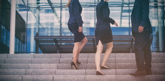 Businesspeople climbing up stairs Stock Photos