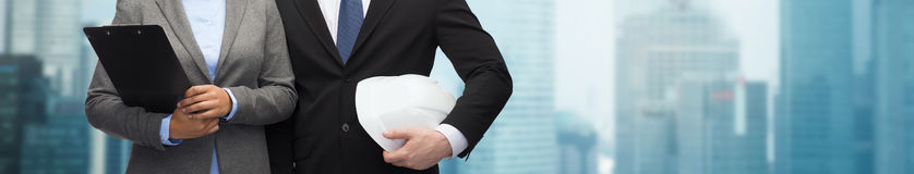 Businesspeople with clipboard and helmet Stock Photography