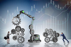 The businesspeople with cogwheel and robotic arm Stock Photo