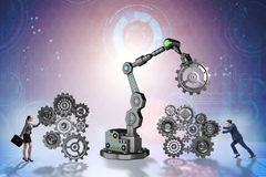 The businesspeople with cogwheel and robotic arm Royalty Free Stock Photo