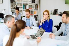 Businesspeople collaborating in office royalty free stock photography