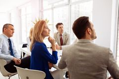 Businesspeople collaborating in office stock images