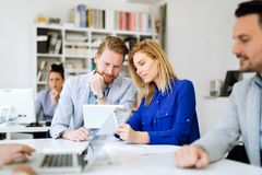 Businesspeople collaborating in office royalty free stock photo