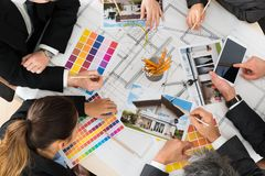 Businesspeople with color samples Stock Image