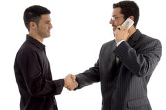 Businesspeople communicating and shaking hand Royalty Free Stock Images