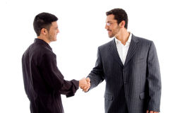 Businesspeople communicating and shaking hand. Against white background Stock Photos