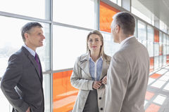 Businesspeople communicating on train platform Royalty Free Stock Images