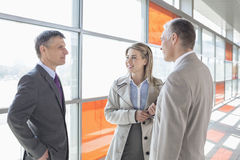 Businesspeople communicating on train platform Stock Images