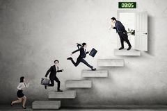 Businesspeople compete to enter the office Stock Photos