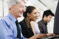 Businesspeople on computers Royalty Free Stock Photo
