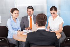 Businesspeople conducting interview Stock Photo