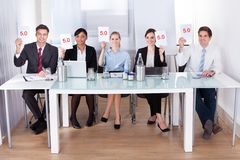Businesspeople in conference holding paper Stock Photography