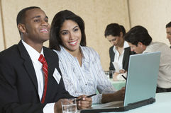 Businesspeople at conference meeting Stock Images