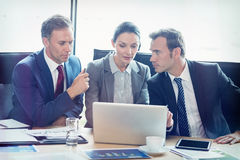 Businesspeople in conference room Stock Image