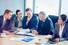 Businesspeople in conference room. Businesspeople interacting in conference room during meeting stock photography