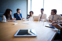 Businesspeople in conference room during meeting. Businesspeople in conference room during a meeting in office royalty free stock photo