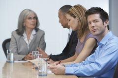 Businesspeople At Conference Table Stock Photo