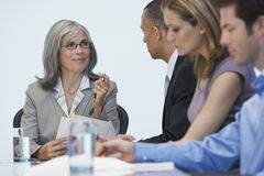 Businesspeople At Conference Table Royalty Free Stock Images