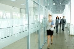 Businesspeople in corridor Stock Photography