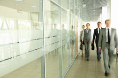 Businesspeople in corridor Royalty Free Stock Photos