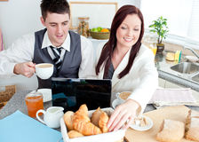 Businesspeople couple with laptop while breakfast Stock Photo