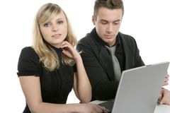 Businesspeople couple with laptop on table Stock Images
