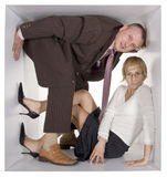 Businesspeople in cube Stock Image