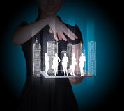 Businesspeople and 3d city model on tablet. In businesswomans hands on abstract blue background Royalty Free Stock Photo