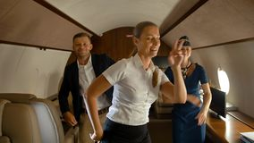 Businesspeople dancing inside of aircraft`s first business class stock footage