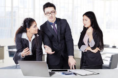 Businesspeople debating in a discussion Stock Images