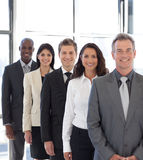 Businesspeople from different cultures. Business team from different cultures looking at camera royalty free stock image