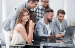 Businesspeople with digital computer having meeting In office stock photo