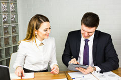 Businesspeople With Digital Tablet Sitting In Modern Office Stock Photography