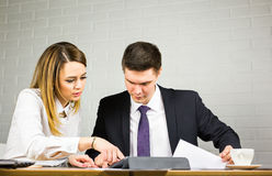 Businesspeople With Digital Tablet Sitting In Modern Office Royalty Free Stock Photos