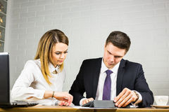 Businesspeople With Digital Tablet Sitting In Modern Office Stock Photo