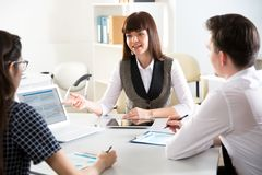 Businesspeople discuss a new project stock images