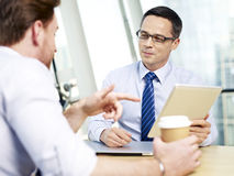 Businesspeople discussing business in office Stock Image